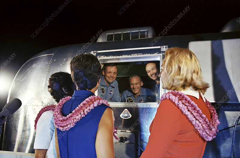 Apollo 11 crew greeting wives from quarantine unit