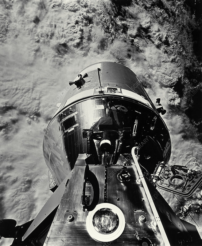Apollo 9 docked command module above earth