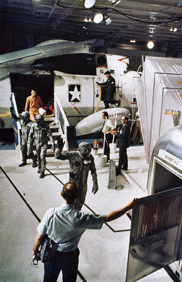 Apollo 11 crew arriving aboard the recovery ship
