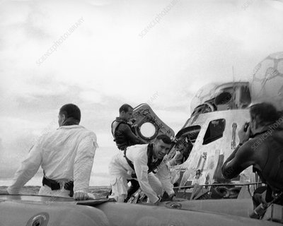 Crew of Apollo 13 leaving capsule after splashdown