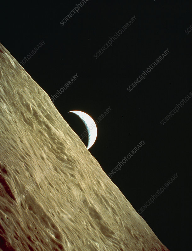 Apollo 17 image of a crescent earthrise over moon
