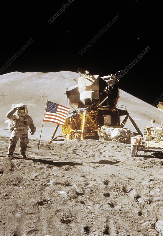 Apollo 15 astronaut Irwin standing next to US flag