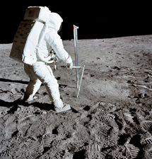 Apollo 11 astronaut Buzz Aldrin taking soil sample