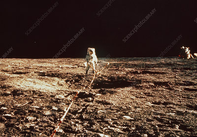 Apollo 12 shot of astronaut with ASLEP experiment