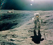 Astronaut Duke next to Plum Crater, Apollo 16