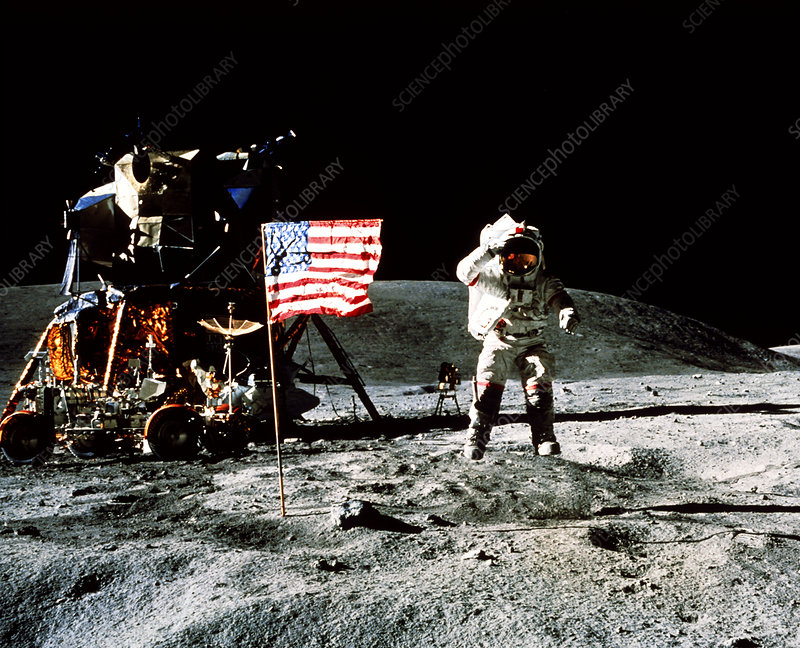 Astronaut saluting US flag on the Moon