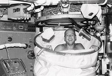 Astronaut Charles Conrad having a shower
