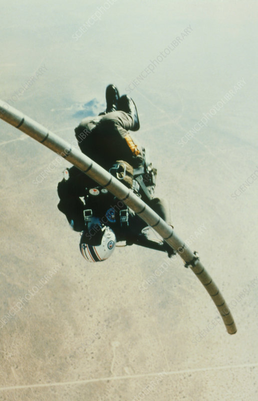 Navy parachutist slides down telescopic pole