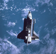Space Shuttle Challenger orbiting earth
