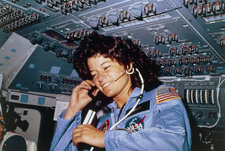 Astronaut Sally Ride talking to ground control.
