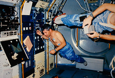 Astronaut demonstrating weightlessness on shuttle.