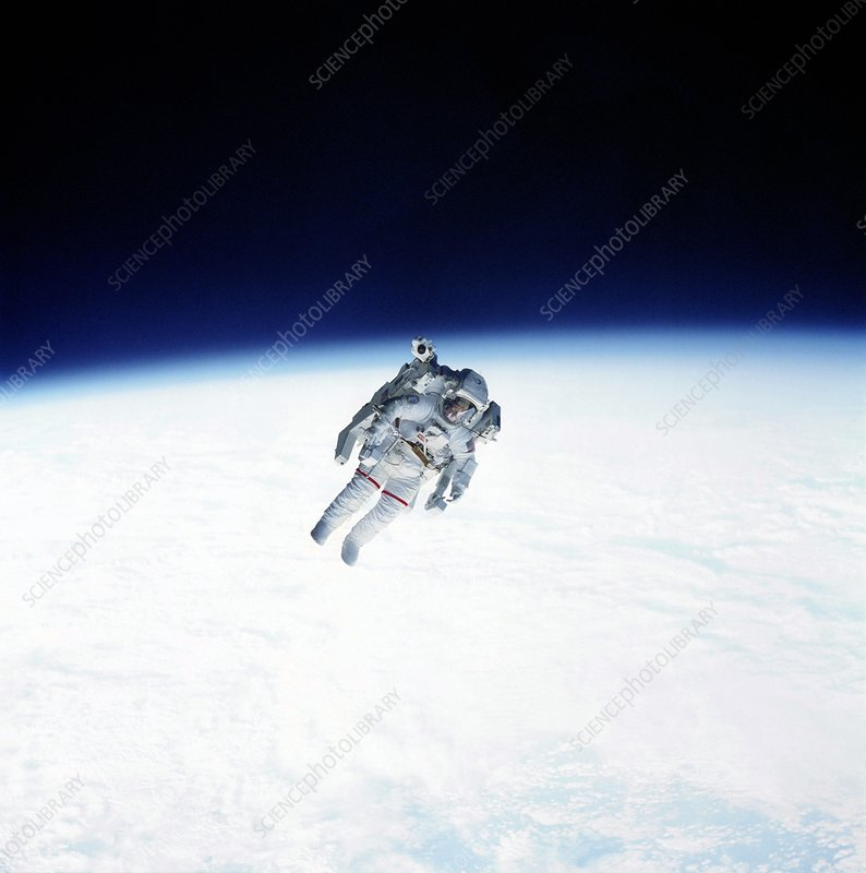 Bruce McCandless floats above the Earth