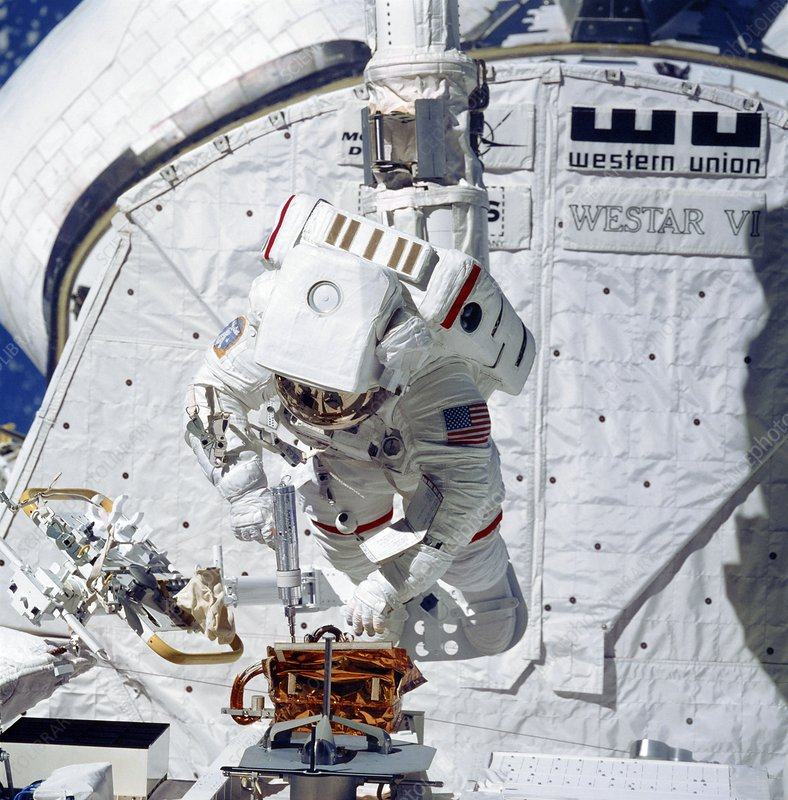 Space Shuttle astronaut during spacewalk