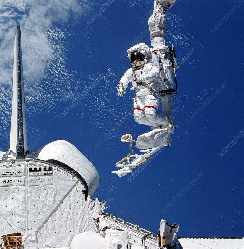 Space shuttle astronaut in MMU spacewalk - Stock Image ...