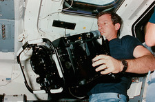 Shuttle astronaut holds IMAX cine camera