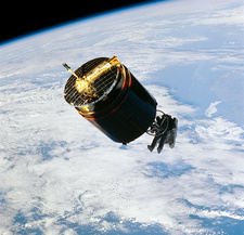 Retrieval of damaged communications satellite.