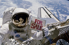 Astronaut holding 'for sale' sign.