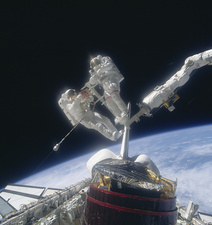 Retrieval of damaged communication satellite