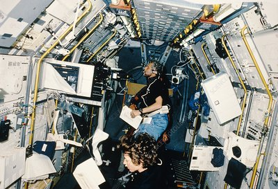 Astronauts working in Spacelab.