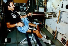 Astronaut performing experiments in Skylab.