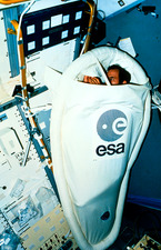 Astronaut demonstrating a sleeping restraint