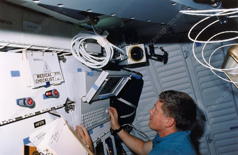 Astronaut Shepherd using portable computer