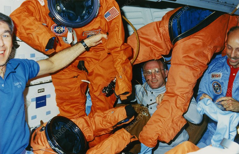 STS-29 astronauts in mid-deck area