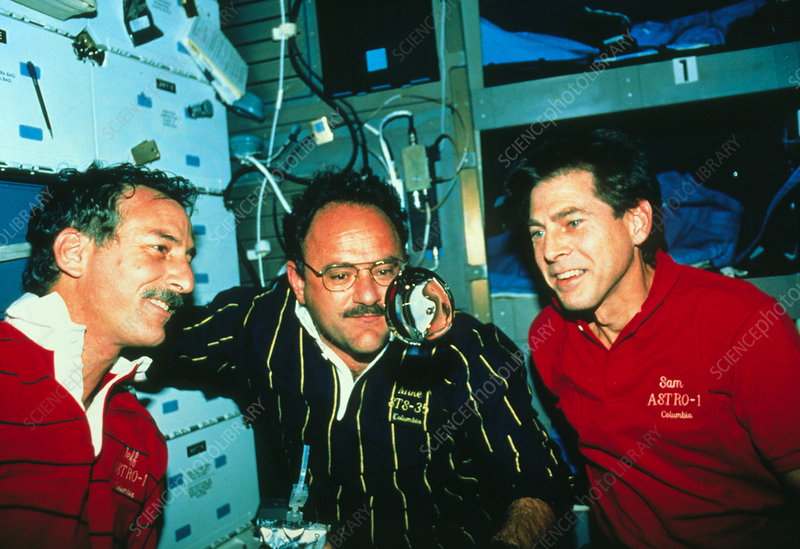 Shuttle astronauts and a weightless water bubble