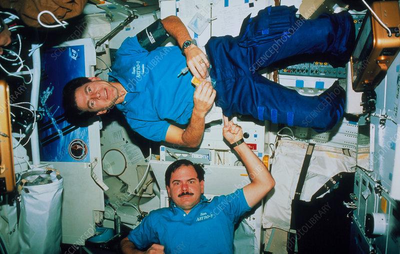 Shuttle astronauts demonstrate zero-gravity - Stock Image ...