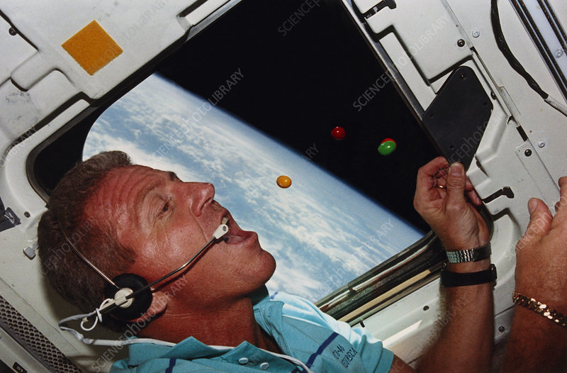 Astronaut Shriver eating M&Ms in space, STS-46