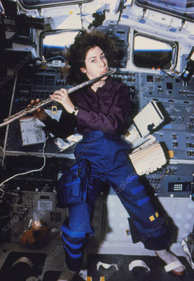 Astronaut Ochoa playing flute on Shuttle, STS-56