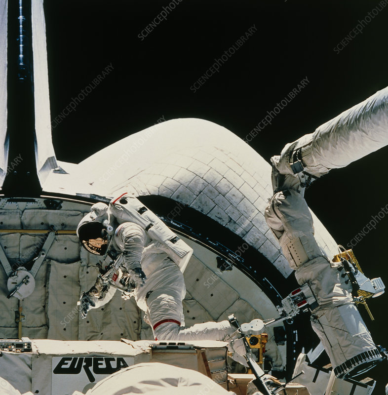 Astronaut Low on RMS arm, STS-57 EVA
