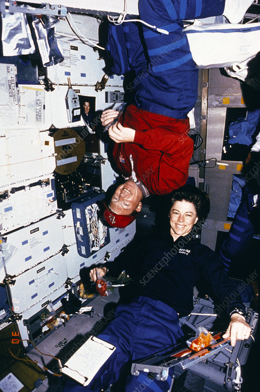 Astronauts Richards and Dunbar eating, STS-50