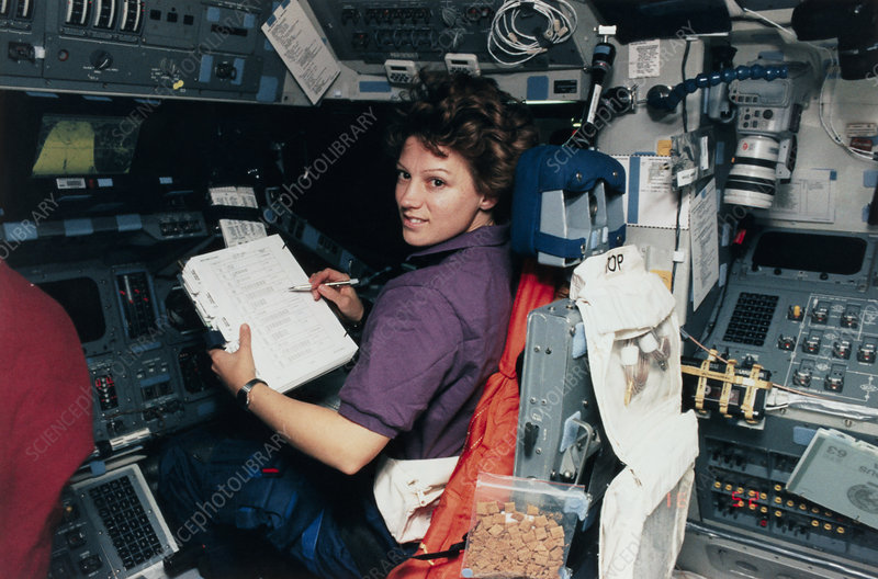Shuttle pilot Eileen Collins at shuttle controls