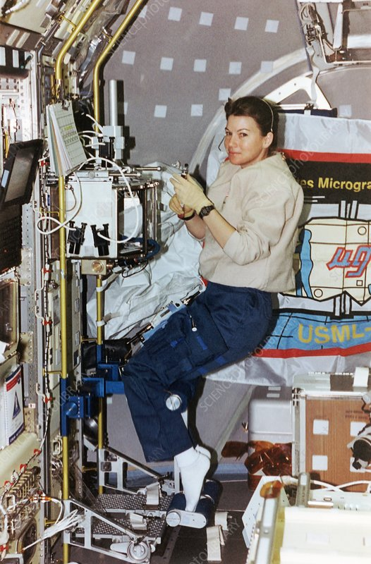 Astronaut experimenting on board the shuttle