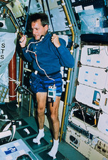 Astronaut exercising aboard the shuttle Columbia
