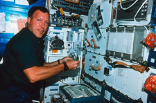 Astronaut prepares meal on space shuttle
