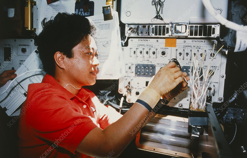 Payload specialist working on board STS-095