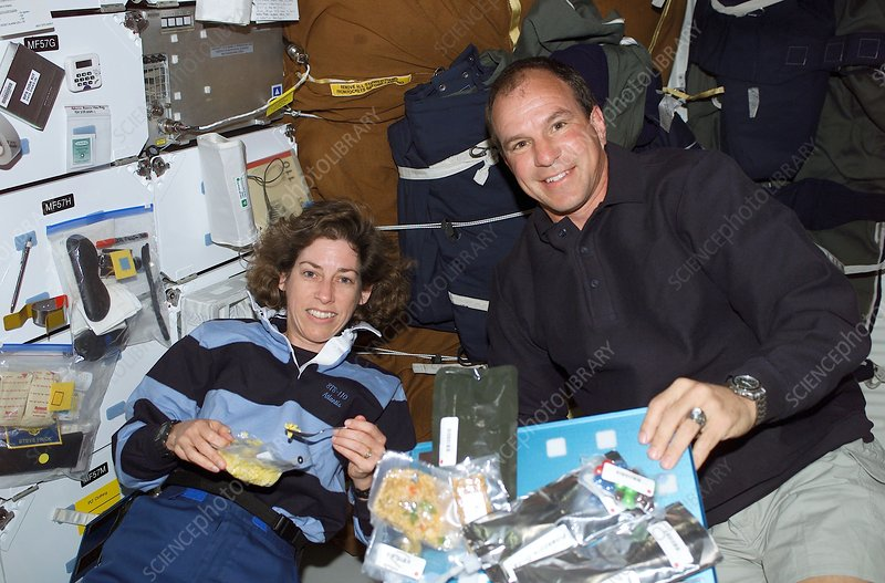 Space Shuttle astronauts eating