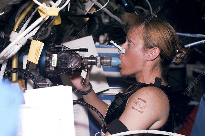 Astronaut perfoming a lung function test