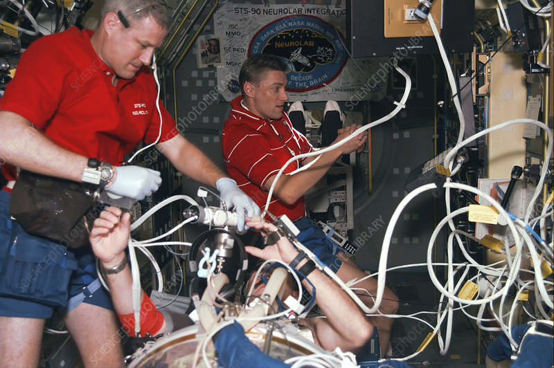 Astronaut testing low pressure device