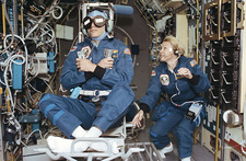 Astronaut in rotating chair, Shuttle STS-58 expt.