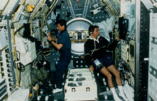 Astronauts experimenting on board shuttle Spacelab