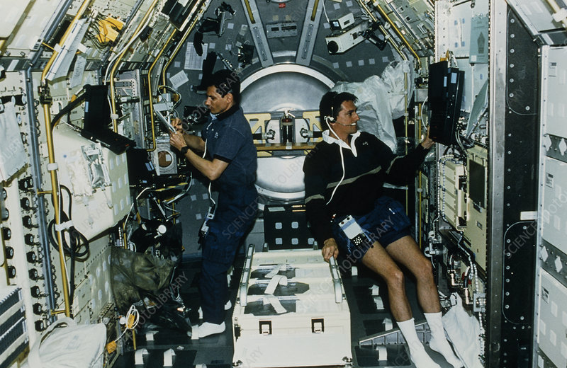 Astronauts experimenting on board shuttle Spacelab - Stock ...