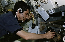 Astronaut experiments on board shuttle Spacelab