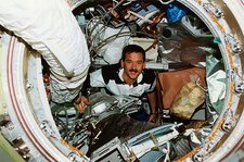 Astronaut inside the space station Mir.