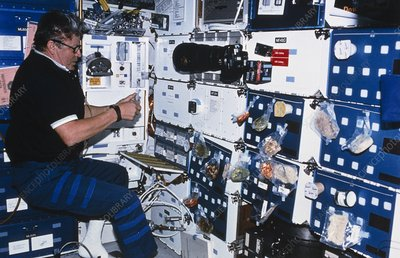 Cosmonaut organises a meal on board space shuttle