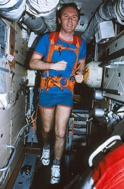 Astronaut uses a treadmill on board Mir