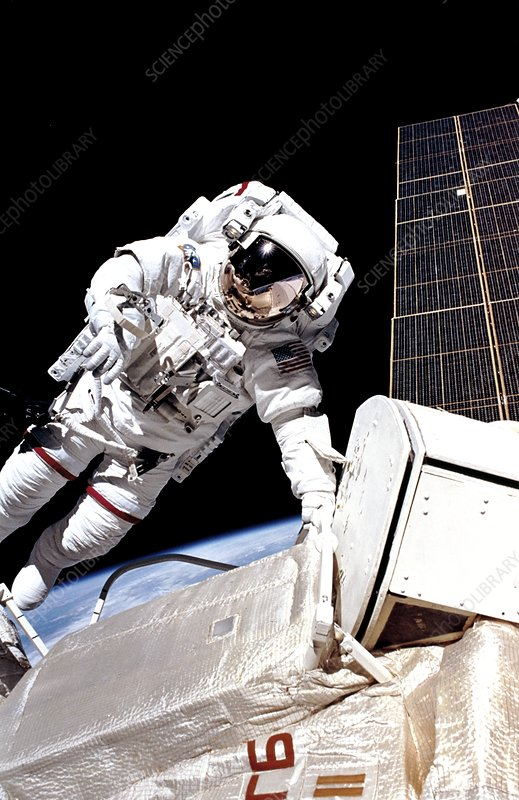 Astronaut J.H. Newman spacewalks on space station