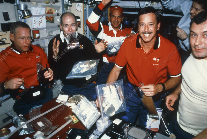 ISS astronauts eating